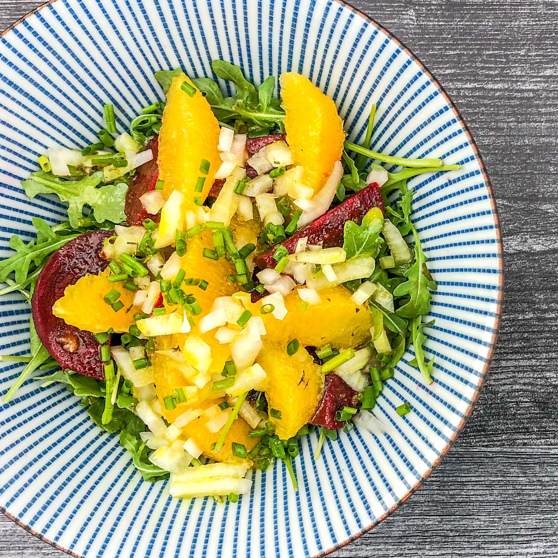 Beets Orange and Arugula in a Salad Bowl