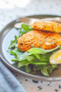 Sweet Potato Fritters on Spinach & Arugula with Olive Oil and Lemon Dressing