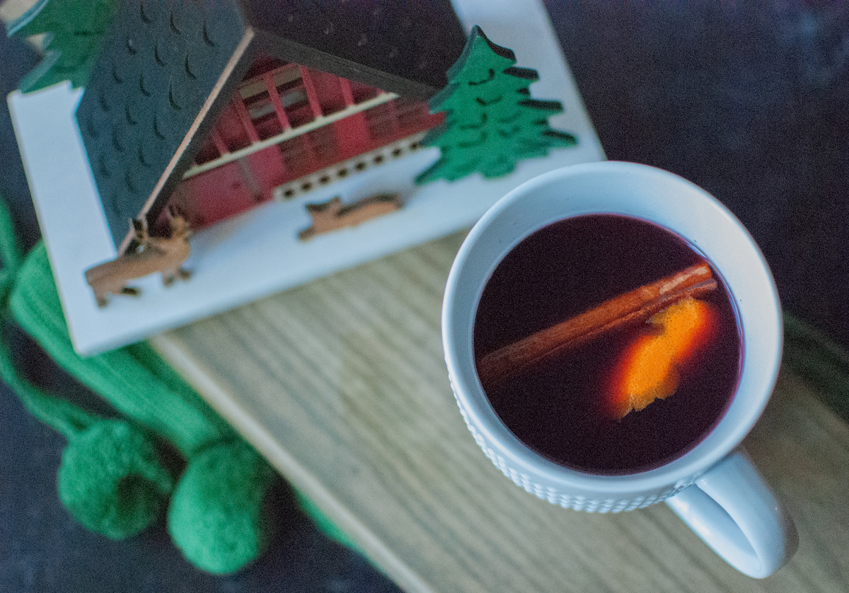 Overhead shot of hot mulled wine with holiday decor